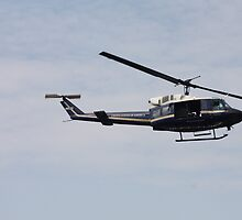 Helicopter Hovering Over The River 2 by goldnzrule