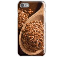 Brown linseeds portion on wooden spoon iPhone Case/Skin