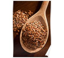 Brown linseeds portion on wooden spoon Poster