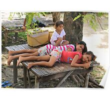 Pretty girls resting under a shady tree, Philippines Poster