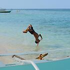 Young filipino boy does a backflip dive Gibitngil Island, Cebu, Philippines by Dave P
