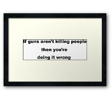 Gun Slogan Framed Print