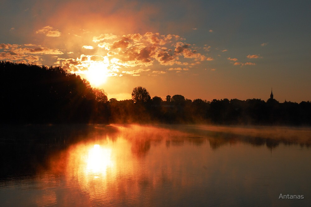 Church, sunrise and fog in the lake by Antanas