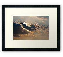 Sun beams bursting through the clouds Framed Print