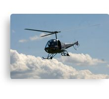 helicopter fly by Canvas Print