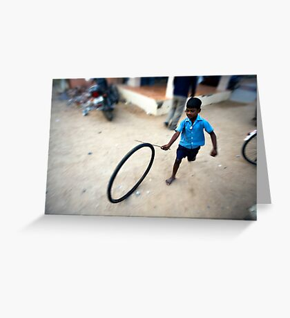 Boy playing with tyre Greeting Card