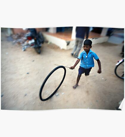 Boy playing with tyre Poster