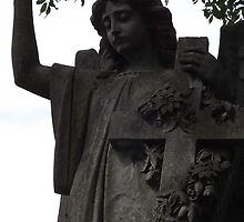 Norwood cemetary: Sculpture: Head/Body/Cross -(220811b)- Digital photo by paulramnora