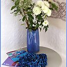 Blue Table Display in Hotel Hallway by BlueMoonRose