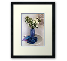 Blue Table Display in Hotel Hallway Framed Print
