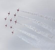 The Red Arrows glistening in the sunlight by Ian Middleton