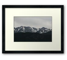 Snow Covered Rockies Framed Print