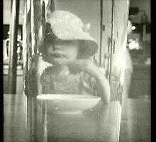 Baby through a pint of beer by menapyne