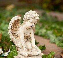 Small angel statue kneel  by Arletta Cwalina