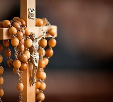 Jesus figurine and rosary  by Arletta Cwalina