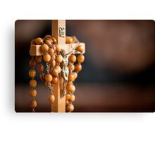 Jesus figurine and rosary  Canvas Print