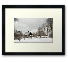 dilapidated wooden house cottage in winter  Framed Print