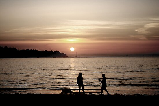 Instow Beach - Sunset and walkers by Toby Wilson