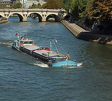 Loaded to the gunnels on the Seine Paris by Paul Pasco