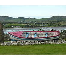 A Retired Boat Beside The Water Photographic Print