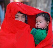 Red  chador  women , Afghanistan by yoshiaki nagashima