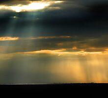 Shafts of lights over The Wash by Richard Flint