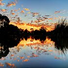 Eyenesbury Lake at Sunset by jonxiv