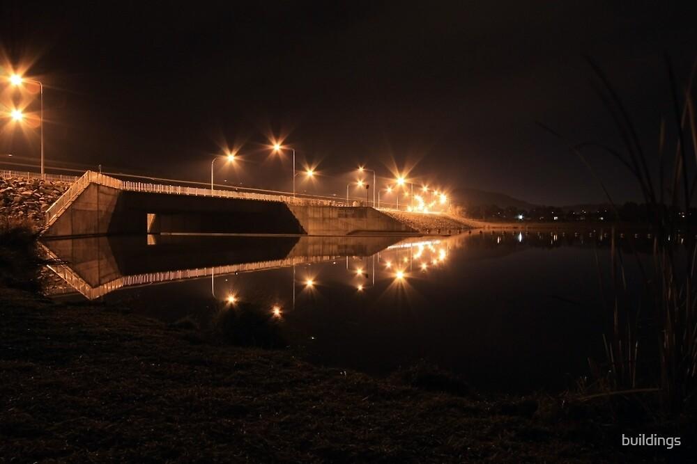 Lake Tuggeranong dam (by night) by buildings