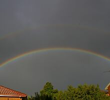 Two Rainbows, Two Pots Of Gold by David McMahon