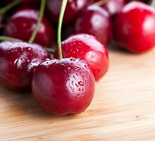 Cherries on Cutting Board by Charlotte Lake