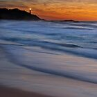 Pebbly Beach and Norah Head by Ian English