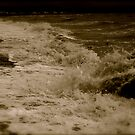 Waves Crashing Against The The Shore by Lou Wilson