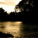 Setting Sun On The Derwent. by Lou Wilson
