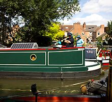 Solar panels on the roof of a narrowboat by Jack Cox