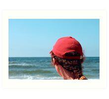 A woman in a red cap Art Print