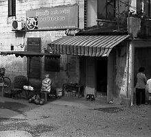 Shop Front, Saigon, Vietnam by Adam Tonge