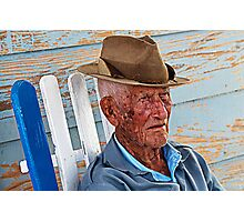 Old Cuban man in rocking chair, Vinales, Cuba Photographic Print