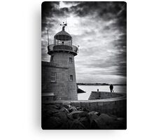 Lighthouse and silhouettes.. Canvas Print