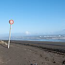 Speed sign on the ocean beach by yurix