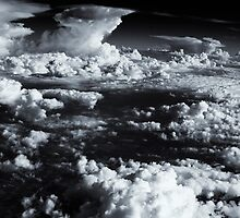 Aerial sea of fluffy white clouds. by Amyn Nasser