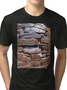 The wall of the large natural stone, painted brown paint Tri-blend T-Shirt