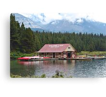 Mountains in the clouds at Maligne Lake boathouse  Canvas Print