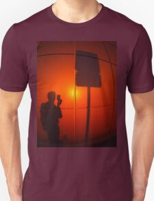 The silhouette of a man on a red-orange wall Unisex T-Shirt