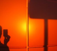 The silhouette of a man on a red-orange wall Sticker