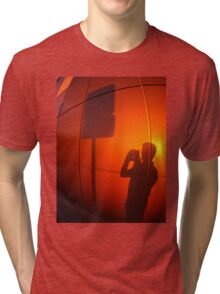 The shadow of a man on a red-orange wall Tri-blend T-Shirt