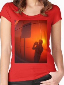 The silhouette of a man on a red-orange wall Women's Fitted Scoop T-Shirt
