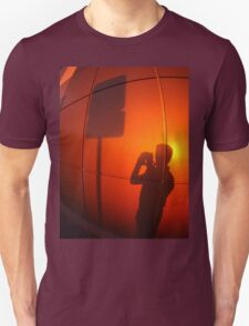 The silhouette of a man on a red-orange wall T-Shirt