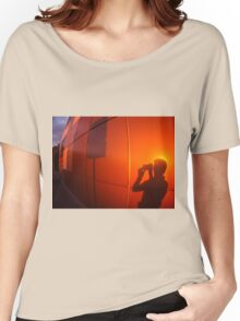 The shadow of a man on a red-orange wall, who photographs a road sign Women's Relaxed Fit T-Shirt