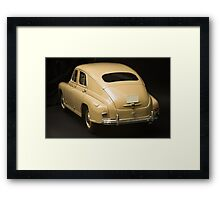 Rear view of retro car on a black background Framed Print