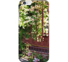 Facade of the building with a brick wall with flowers iPhone Case/Skin
